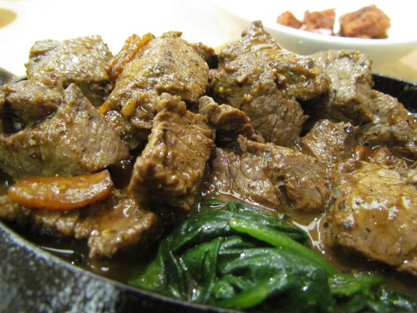Sauteed beef cubes with onions & greens