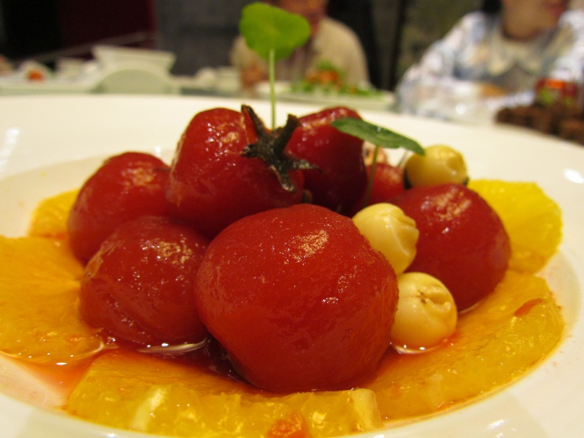 Poached tomatoes with orange, lotus fruit & apple slices.