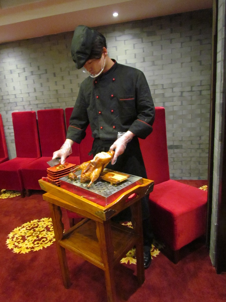 Peking Duck brought into Dining Room in a trolley & cut into slices