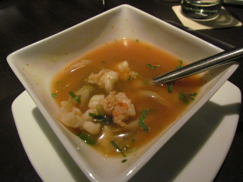 Spicy lemon grass & kaffir lime flavored tom yam soup with prawns