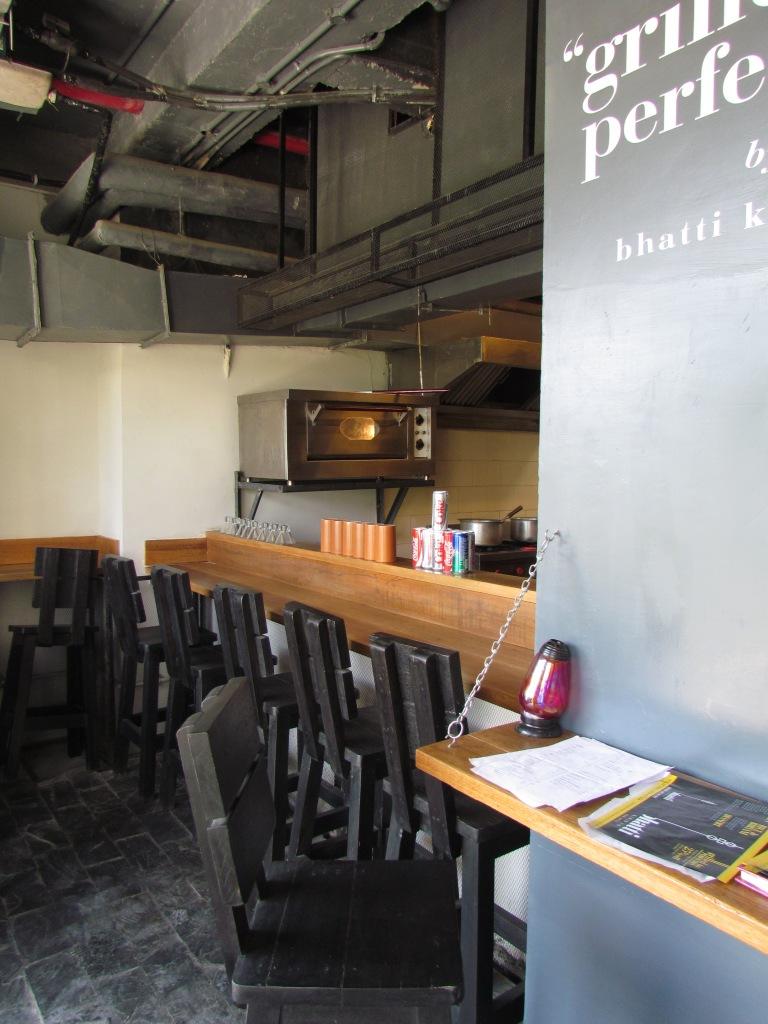 teppanyaki style hi stool seating near the open kitchen