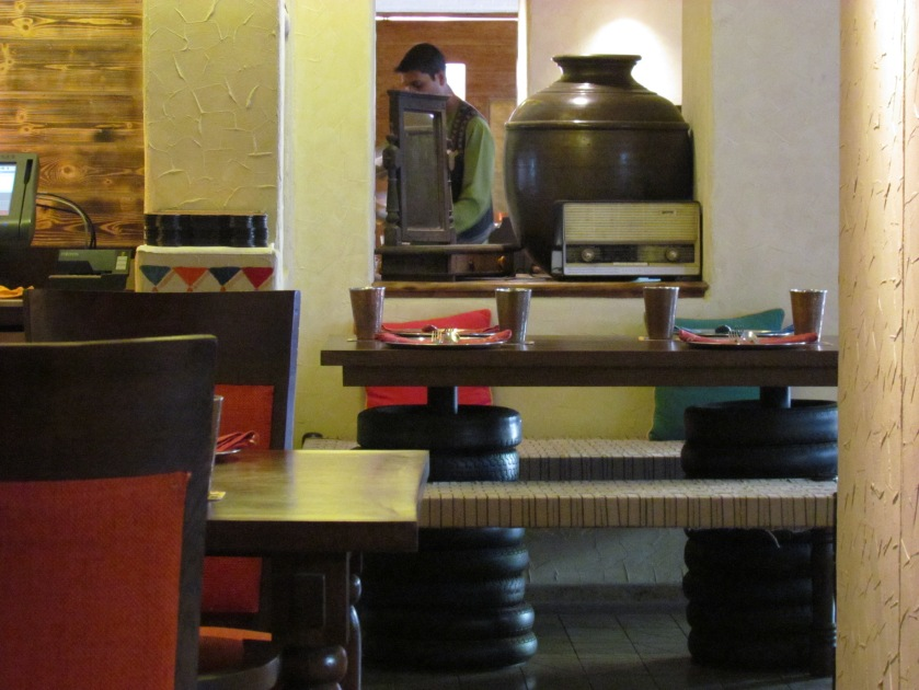 A old radio set, a huge pitcher, tyres lined up ................... look & feel of a dhaba incorporated