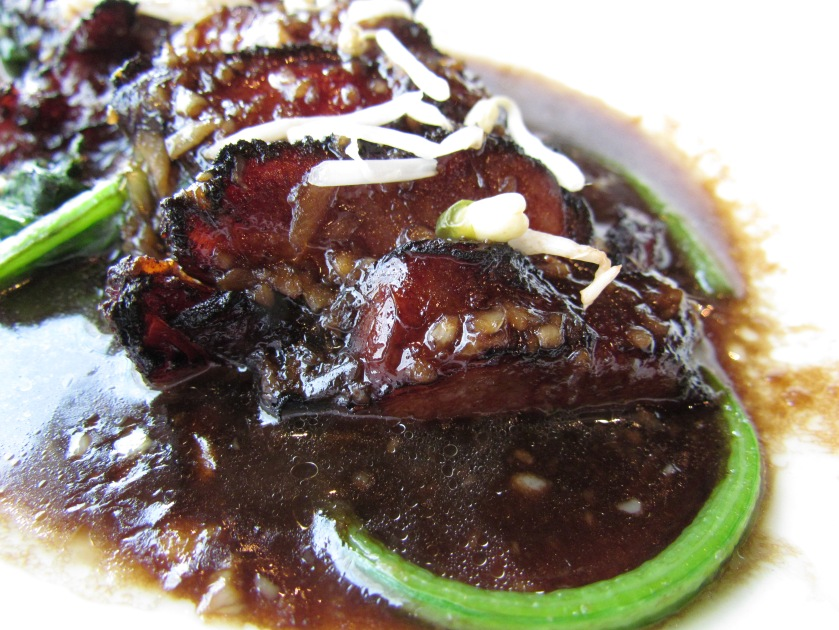 Thai toast duck on a bed of spinach