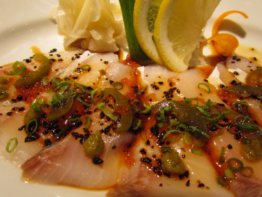 yellow tail tuna (fish) sashimi with yuzu kosho and jalapeño