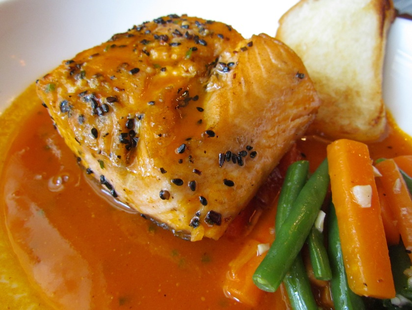 Salmon with skin in a watermelon curry with carrots French beans