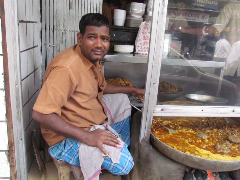 Guy near the entrance making mutton tikia & chaap