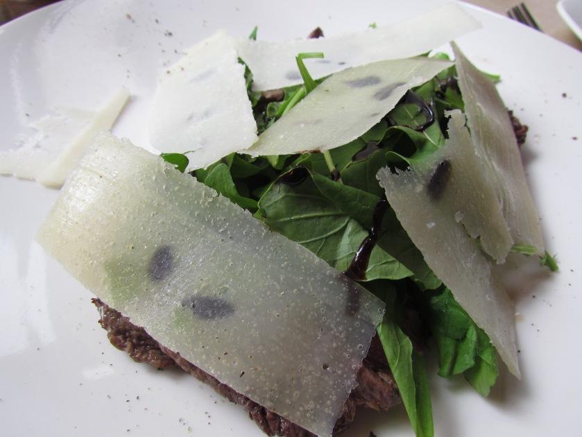 Tagliata sliced grilled tenderloin served with rocket and Parmesan'