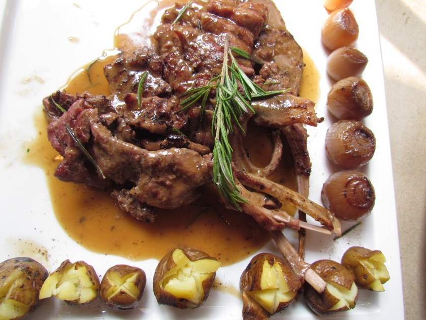 Scottaditto grilled beaten lamb chops tossed in Demi glacé, served with roasted baby onions and potatoes