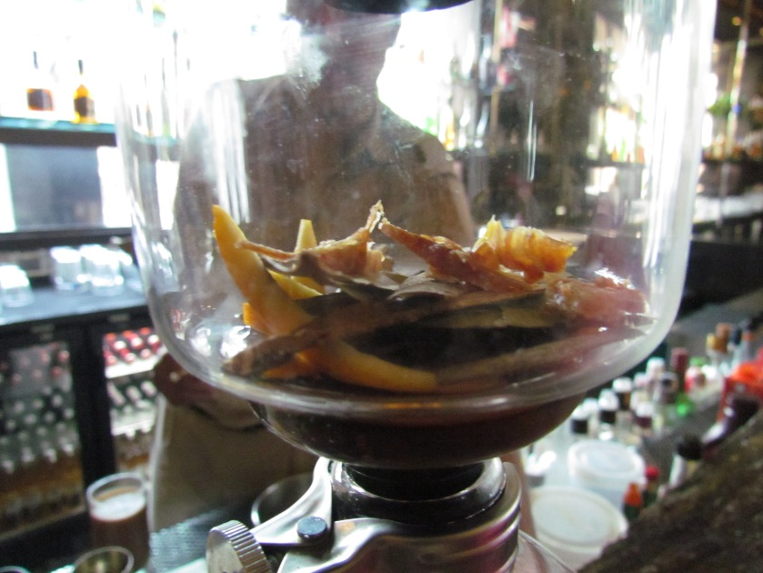 Aini - being made . Spices & orange peel infused alcohol