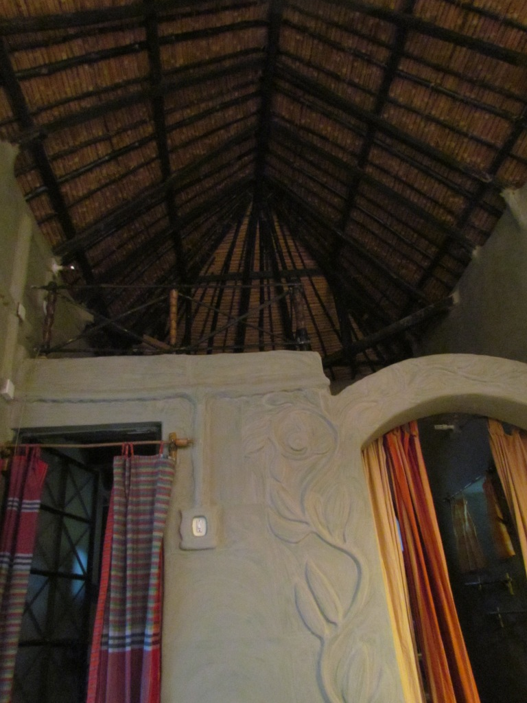 the mezzanine floor with a double bed, high ceiling made on bamboo frame & with dried grass