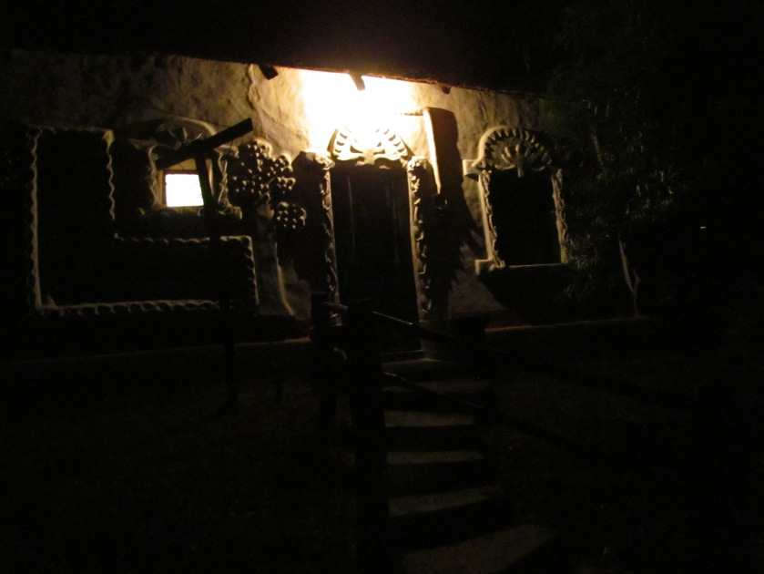 outside the hut in the dark