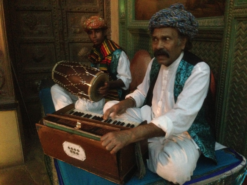 Rajasthani folk singers just outside the restaurant singing a traditional Rajasthani song at our request