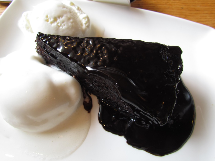 Warm gooey mushy chocolate cake with vanilla ice cream
