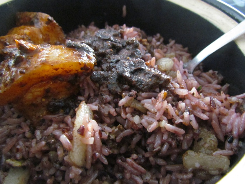Wild red rice with pork and herbs