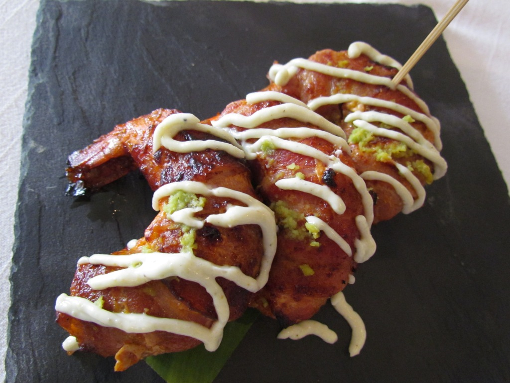 Tandoori bacon prawns topped with wasabi malai cream