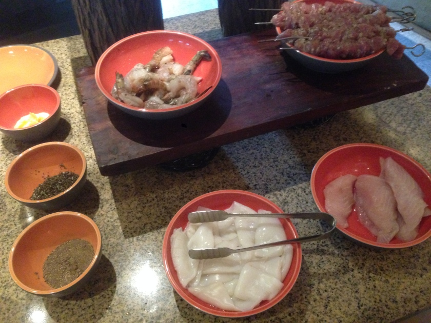 Different raw items kept in teh buffet, ready to b grilled