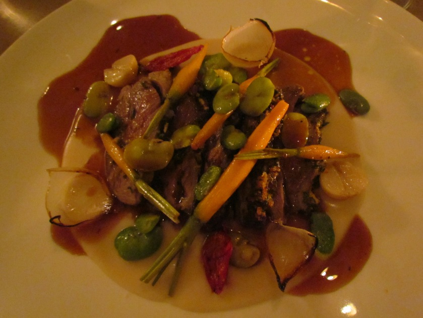 Lavender scented Australian lamb rump with baby vegetables, semi fried tomatoes, broad beans & white onion jus