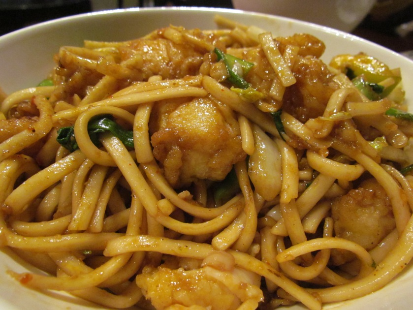 Wok fried udon noodle tossed with sliced fish in oyster chilli sauce