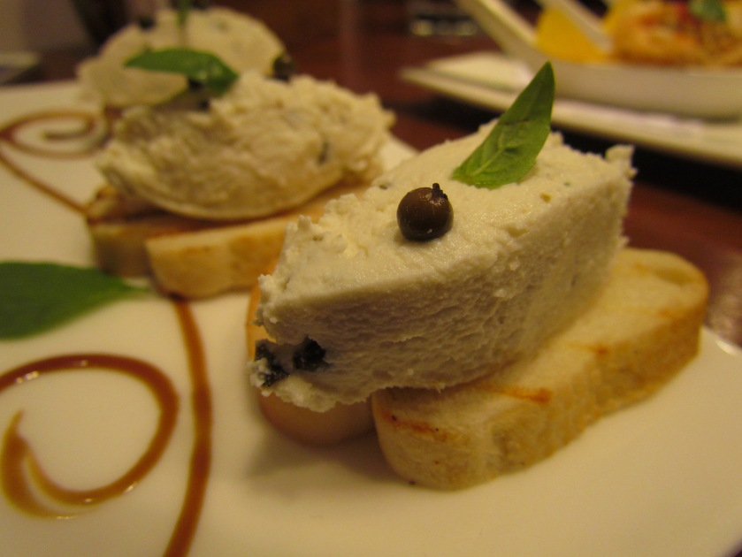 Peppered goat cheese crostini
