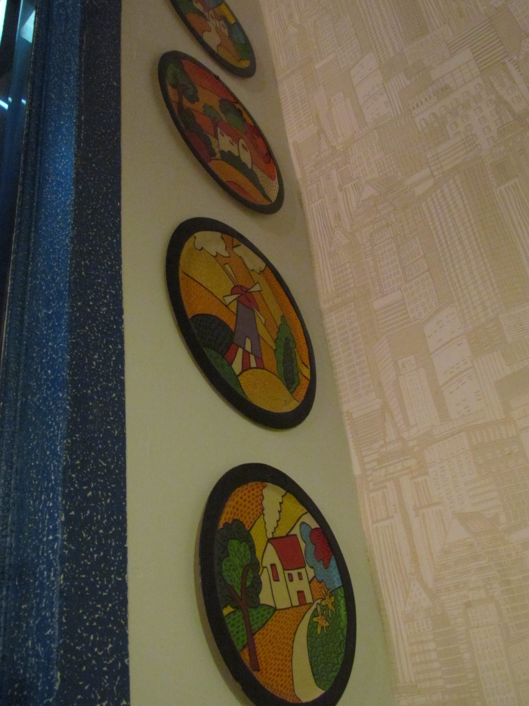 a section of the wall paper & wall hangings