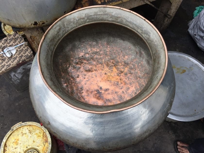 copper vessels being used to cook food