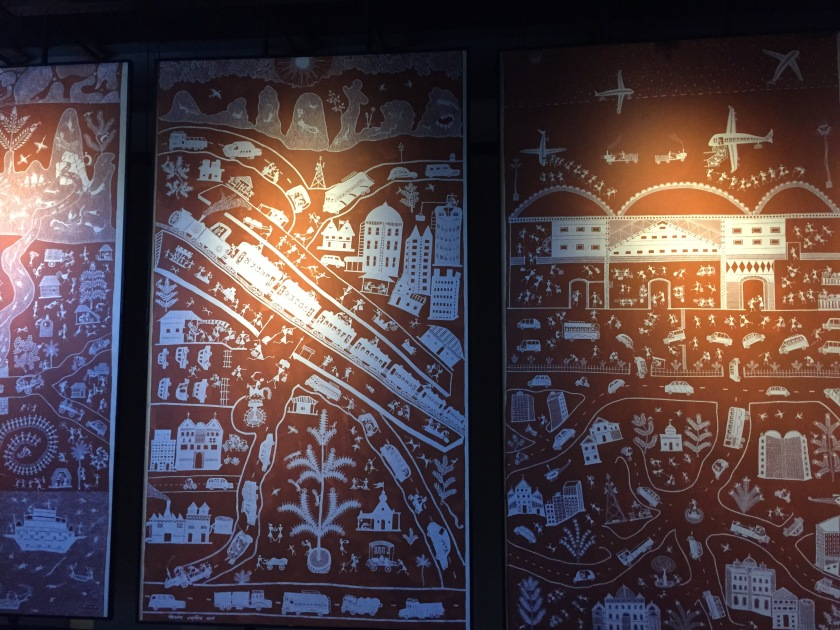 Tribal art depicting transportation and city life - their perspective