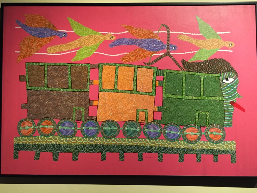 Gond tribal art - depicting a train in their traditional art form