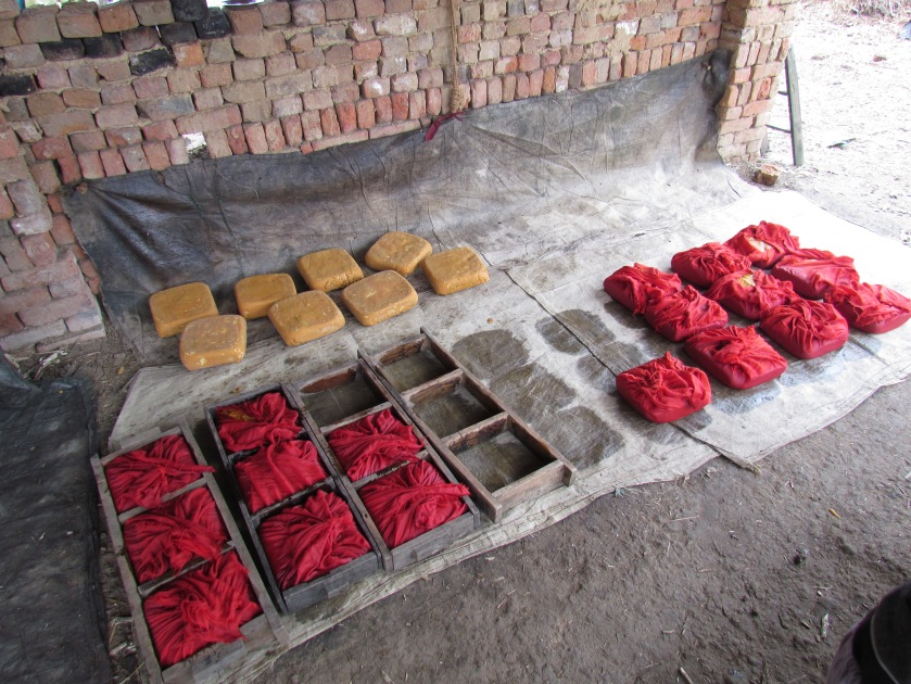 moulds, red cloth & gur - giving it shape