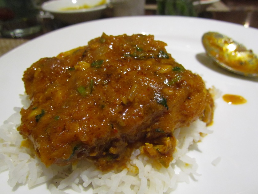 Anglo Indian fish curry poured atop plain rice