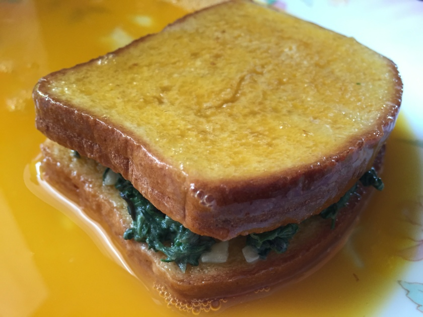 prepared bread slices with spinach in middle