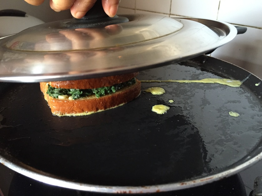 use a lid to press & cover the sandwich