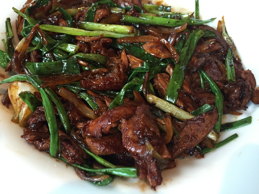 sauteed duck meat from the remains of Peking Duck