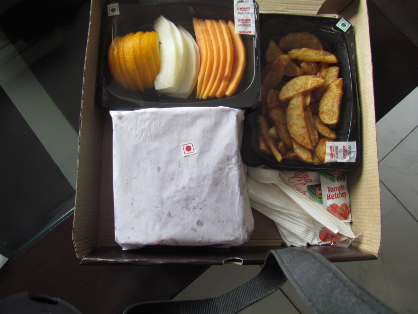Nonveg club sandwich with potato wedges & fresh fruit platter
