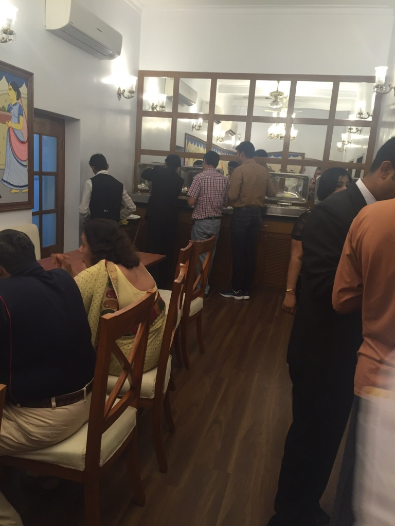 Guests queuing up at buffet counter