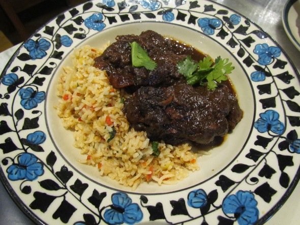 Cardoz's braised oxtail in a hot and sticky jus with rice pilau and carrots