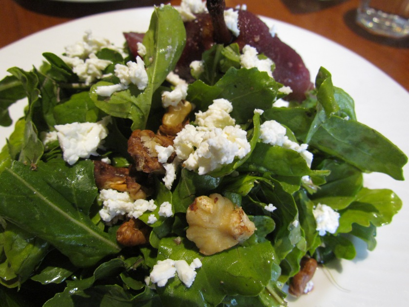 Poached pear salad with goat cheese