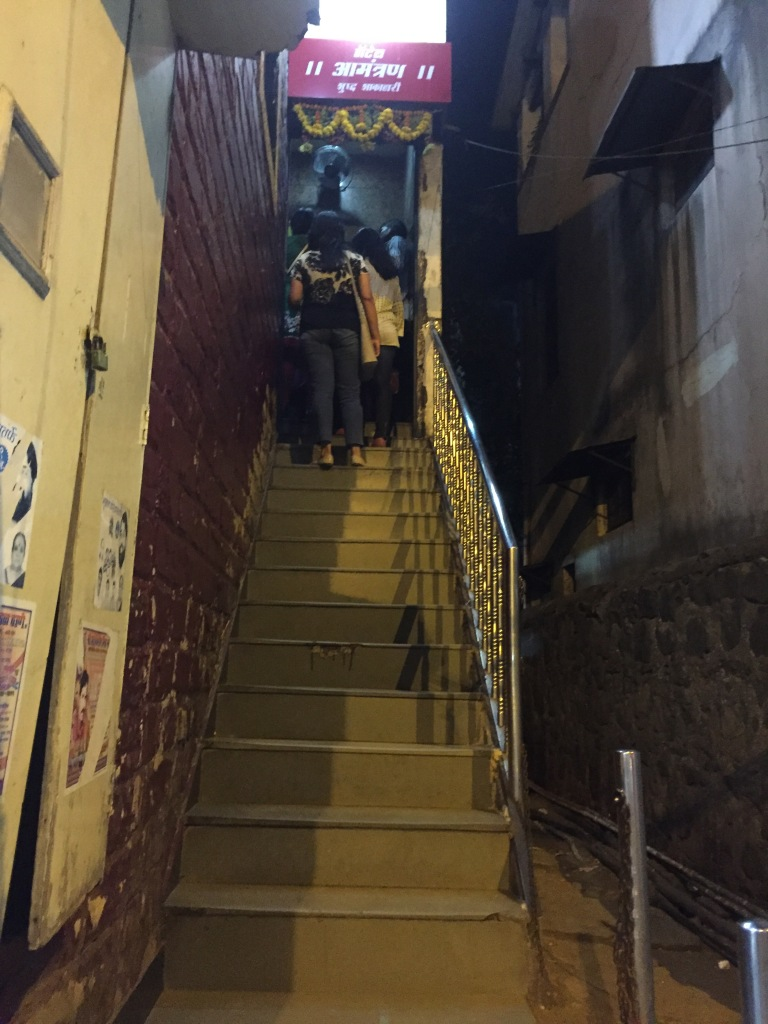 The staircase going up to the first floor