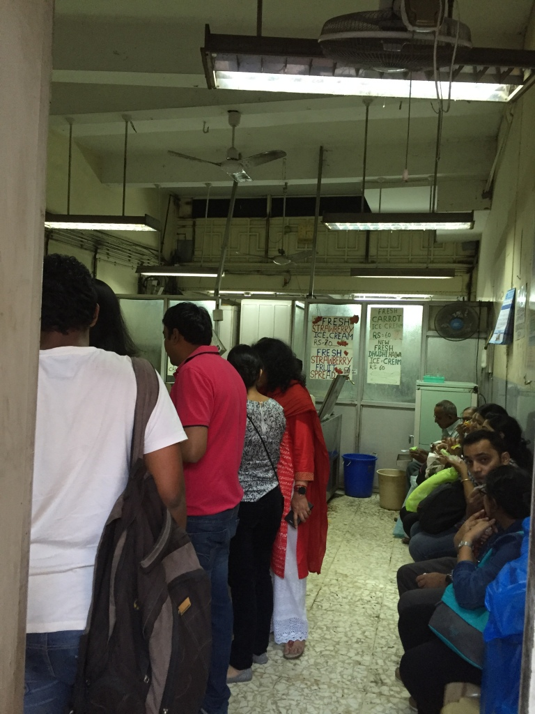 inside the shop - people collect the food standing. There is option to sit & eat