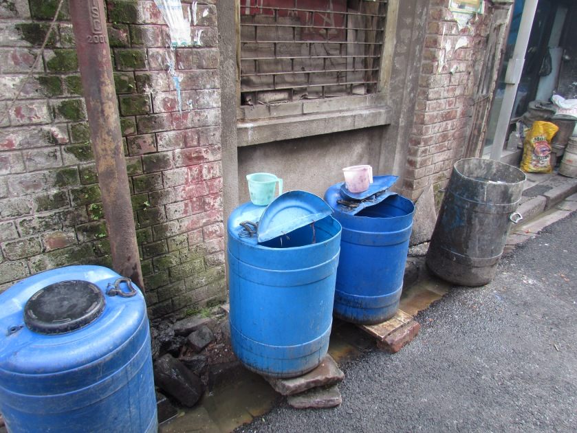 They had bins to throw trash & also water stored to wash hand.
