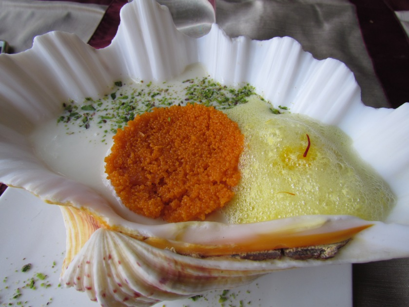 jalebi caviar with rabri & saffron foam, presented in a beautiful vessel.