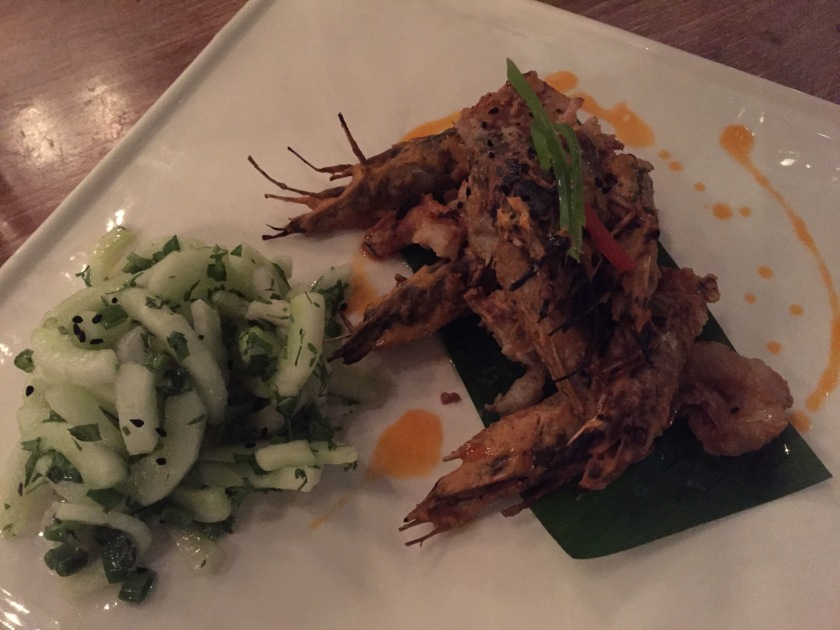 Mango pickled grilled prawns with cucumber and onion slaw
